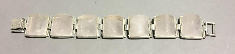 A silver and quartz bracelet
