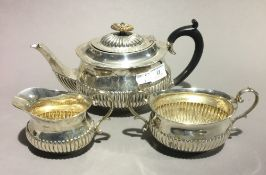 A silver three piece tea set
