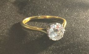 An 18 ct gold diamond set solitaire ring (approximately 1 carat)