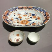 An 18th century Japanese Imari barbers bowl and two Chinese tea bowls