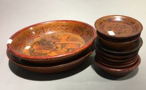 A quantity of Chinese wooden bowls