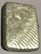 An embossed cigarette case