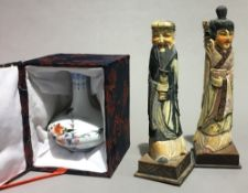 A pair of Chinese painted bone figures and a Chinese vase