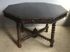 A Victorian carved oak centre table on barley twist carved stretchered legs