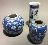 Two Chinese blue and white ginger jars and a Chinese sleeve vase