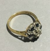 An 18 ct gold diamond and sapphire set ring (3 grammes all in)