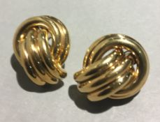 A pair of 9 ct gold earrings