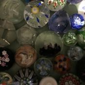 A large collection of paper weights