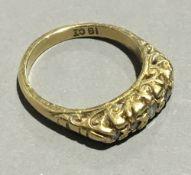 An 18 ct gold five stone diamond ring