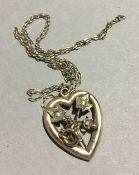 A 9 ct gold heart shaped pendant on 9 ct gold chain (2 grammes all in)