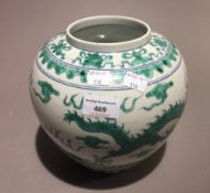 A Chinese porcelain vase decorated with dragons