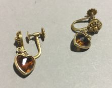 A pair of gold heart shaped earrings