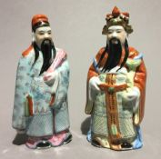 A pair of Chinese porcelain figures