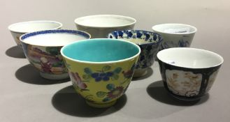 A small collection of porcelain tea bowls