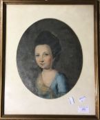 A framed oil portrait of a young lady
