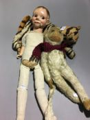 A vintage ventriloquist doll and two cuddly toys