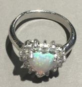 A silver and opal ring