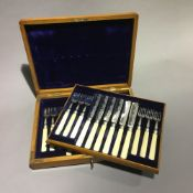 A cased set of silver and ivory fish knives and forks