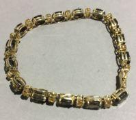 A 14 K gold citrine and smoky quartz bracelet