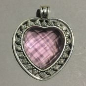A silver and pink stone heart pendant