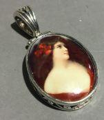 A silver pendant set with a miniature portrait