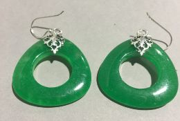 A pair of silver and jade earrings