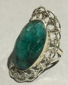 A silver and jade ring