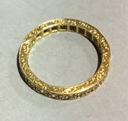 An 18 ct gold hand engraved full eternity ring (3.