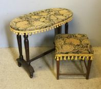 A covered oval table and a covered stool