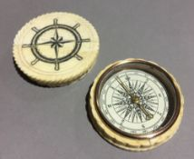 A bone cased compass