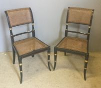 A pair of Regency style painted caned side chairs
