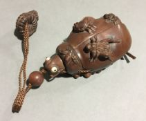 A wooden inro formed as insects