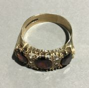 A garnet set 9 ct gold antique style ring (4 grammes total weight)