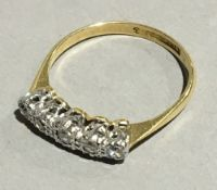 An 18 ct gold five stone diamond ring (2.