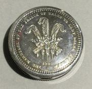 A silver round pill box
