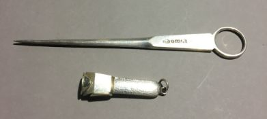 A silver cigar cutter and a silver plated meat skewer