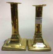 A pair of 19th century brass candlesticks