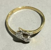 An 18 ct gold two stone diamond crossover ring (1.