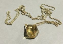 A citrine pendant on a 9 ct gold chain (1.