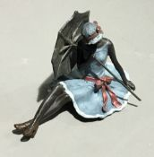 A cold painted bronze girl with an umbrella