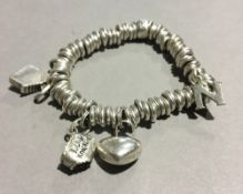A Links of London silver bracelet with charms,