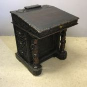A Victorian carved oak Davenport incorporating some earlier elements
