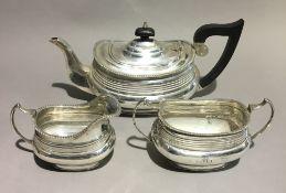 A three piece silver tea set