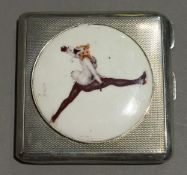 A silver compact decorated with an Art Deco skater