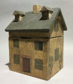 A house form tea caddy