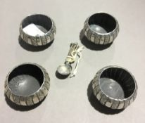 Four silver salts and spoons