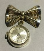A ladies 14 ct gold Omega watch on a 9 ct gold bow shaped brooch top (8.
