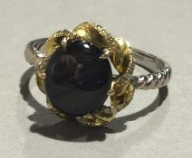 An 18 ct gold star sapphire and diamond ring (4 grammes total weight)