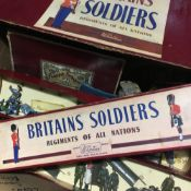 A quantity of Britains lead soldiers, farm yard equipment. etc.