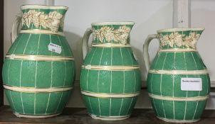 A graduated set of three Staffordshire Alloa Cobridge ware jugs